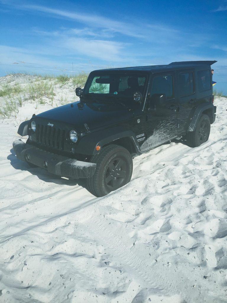 Black Jeep on the beach.