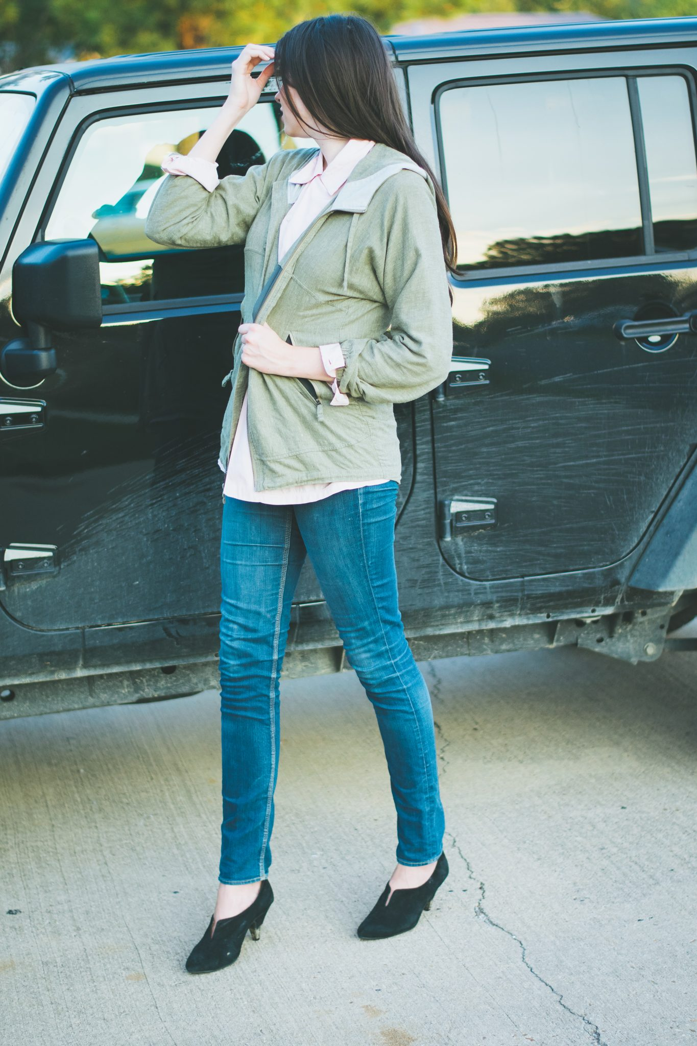 Blush pink blouse with olive green patagonia jacket.