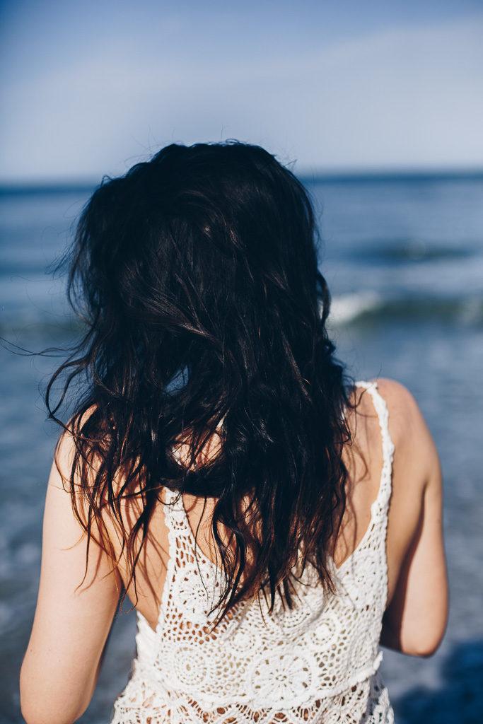 brunette hair and crochet tank top