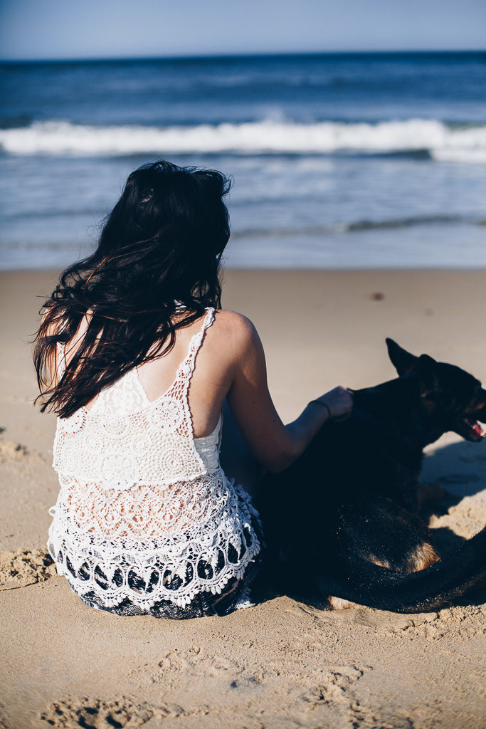 girl and her dog on the beach