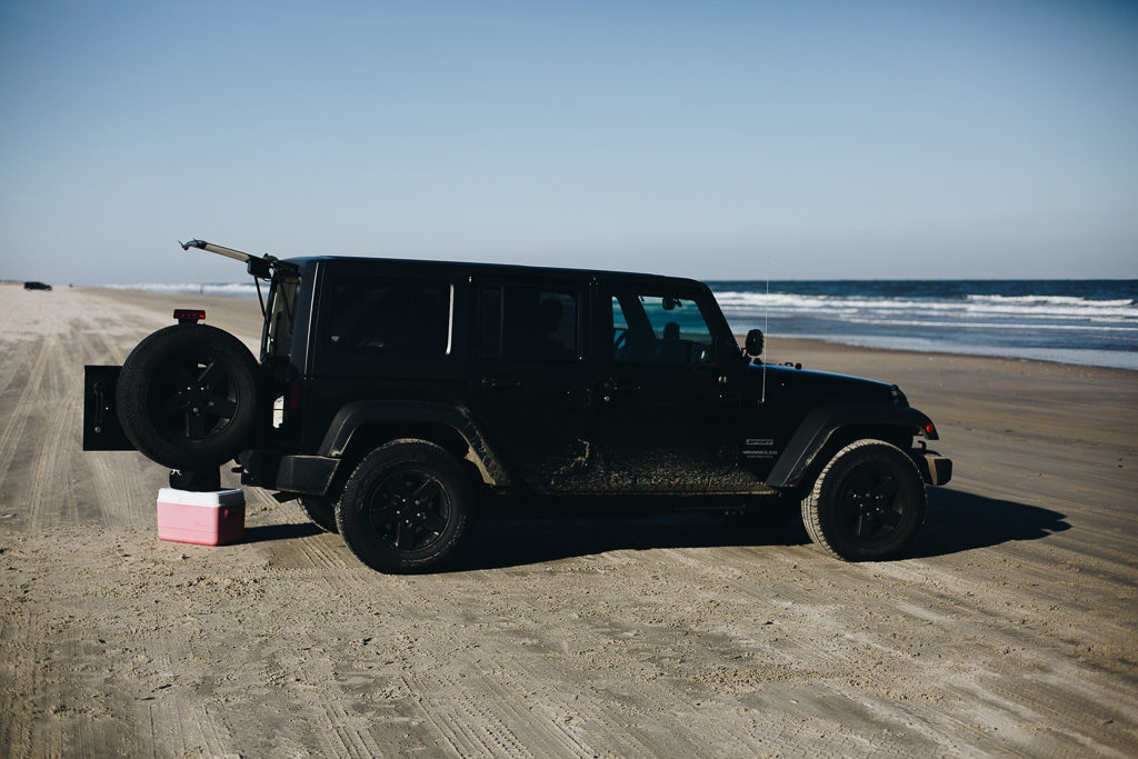 black jeep on the beach