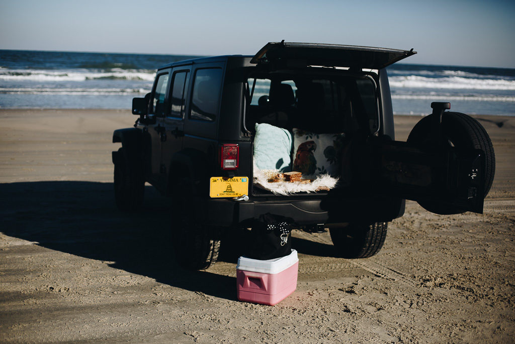 black jeep wrangler on the beach