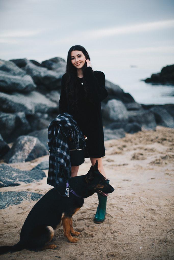 black sweater dress and plaid scarf