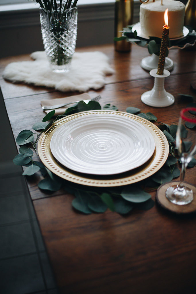 white china with gold charger
