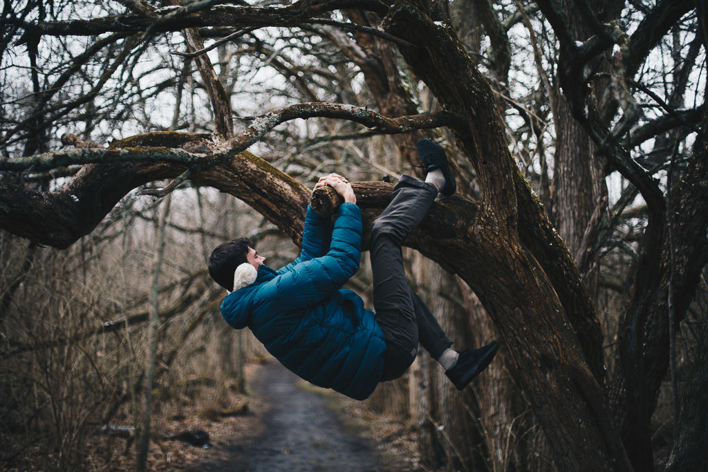boy climbing trees