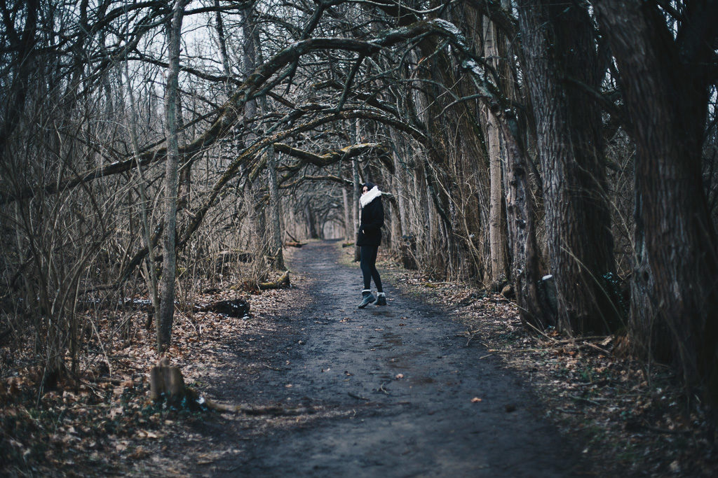 walking down a wooded path