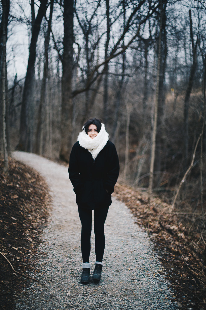 black hiking outfit with white scarf