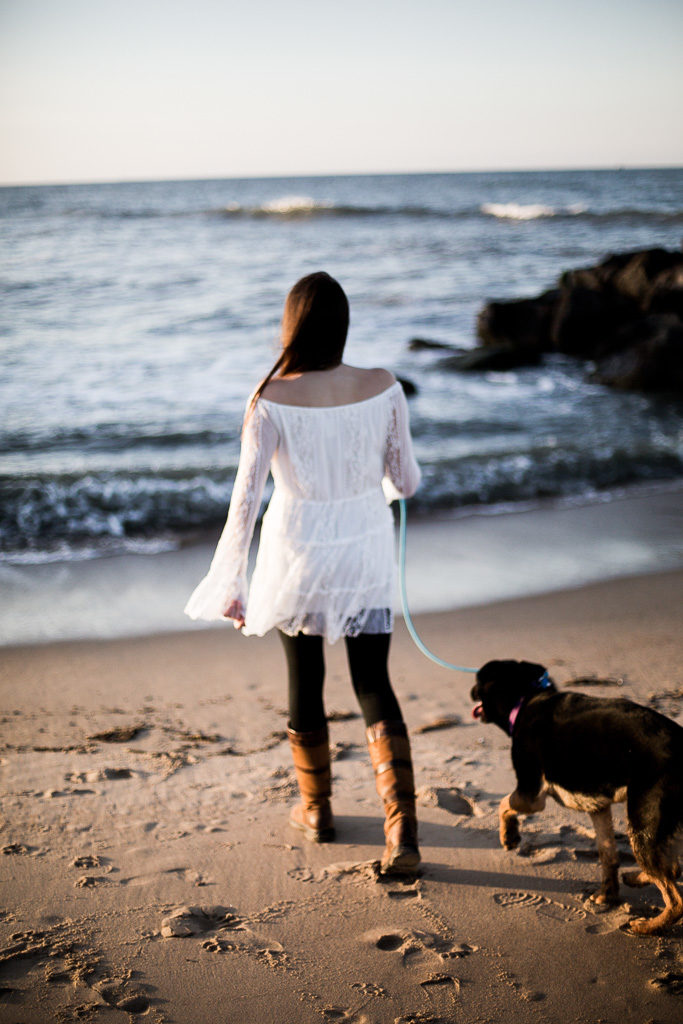 girl and her dog at the beach