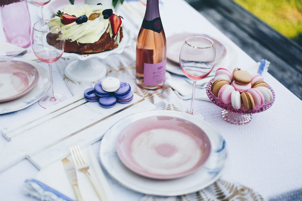 pink plates with gold flatware